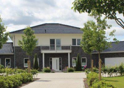 Stadtvilla mit Anbauten als Architektenhaus im Landkreis Cloppenburg